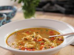 Chicken Rice Soup Recipe from Food Network // I mostly followed this, but I cooked in the pressure cooker for 10 min. and added cooked rice afterwards.