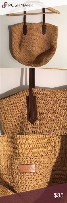 J Crew Paper Straw Market Tote Super cute summer bag. Leather straps. Interior pocket. One tiny loose thread at handle  as pictured. Roomy enough for a trip to the farmers market or beach. J. Crew Bags Totes