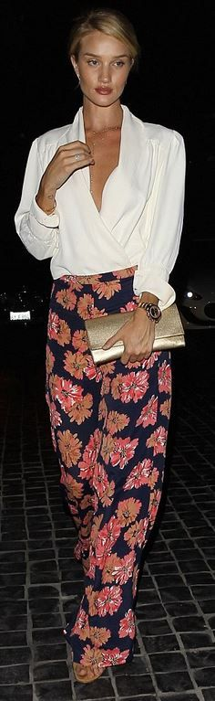 Who made  Rosie Huntington-Whiteley's gold jewelry, print pants, clutch handbag, and brown suede sandals?
