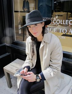 Trench coat, glossy leggins and a brimmed hat / New York street style