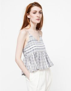 A relaxed fit top from Farrow with allover textured stripes. Features a v-neckline, spaghetti straps and a loose, relaxed fit through the torso.  	•	Sleeveless top with allover textured stripes 	•	V-neckline 	•	Spaghetti straps 	•	Loose, relaxed fit
