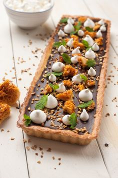 Ultimate chocolate tart with hazelnuts recipe, with vanilla meringues and honeycomb. A perfect dessert for the holidays.