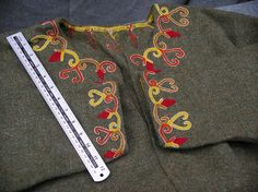 Tunic with embroidery based on Valsgärde textiles. From Threads of Time. This is the one of the patterns on Thora's viking embroidery hand out that I found years ago.