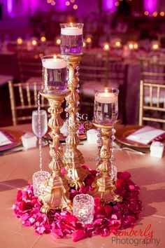 Simple candlestick centerpiece with surrounding flowers and votives, great indian wedding reception centerpiece idea, it's more cost effective than using full flowers Indian Wedding Decorations, Reception Decorations, Wedding Themes, Indian Decoration, Pakistani Wedding Decor, Desi Wedding Decor, Backdrop Wedding, Reception Table, Table Decorations