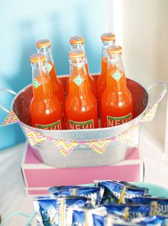 Orange soda in cute tin bucket with bunting. Cute idea for a birthday party!