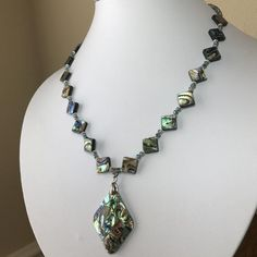 Abalone shelll beads in a diamond shape, with a mosaic diamond shape abalone pendant. The abalone beads are accented with blue/green crystals Abalone Jewelry, Abalone Shell, Shell Necklaces, Diamond Shapes, Blue Green, Mosaic, Shells, Beaded Necklace, Buy And Sell