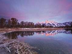 Grand Teton  Photograph by Christopher Zimmer, My Shot    The peaks of the Teton Range are seen at sunrise from Schwabacher Landing, Wyoming a popular viewing point. Unencumbered by foothills, the regal and imposing peaks make one of the boldest geologic statements in the Rockies.