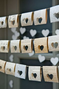 Punch heart shapes through old book pages to create this pretty bunting.
