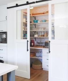 Love the barnhouse doors on the pantry, especially the glass inserts.