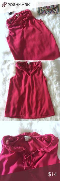 J. Crew Pink Ruffle Collar Top Blouse Size 0 Pink sleeveless blouse Super soft, comfortable, and breathable Ruffle collar trim around the neck Cute blouse to pair with shorts or dress up under a suit. Gently used condition No stains or fading Slight pilling in collar Tiny hole near the shoulder area but hardly  noticeable and the ruffle draping conceals it Lace Tie front (some wearing)  Material 100% Polyester Size 0 J. Crew Tops Blouses