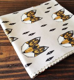 TinyGoldenArrows - https://www.etsy.com/listing/183814228/organic-cotton-knit-swaddle-blanket