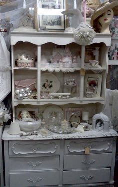 I adore the little pink house and fence on the top shelf. I have to do this in my display hutch!