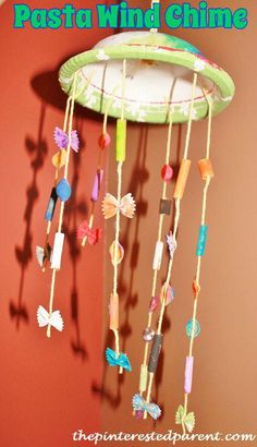 A wind chime made out of painted pasta pieces. A sweet spring craft for your small crafter's.