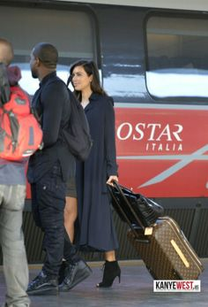 Kim Kardashian wearing Louis Vuitton Pegase suitcase Hermes 35cm Birkin Bag in Black Croc Tom Ford Fall 2011 Ankle Boots. Kim Kardashian Boarding a train in Italia October 21 2012.
