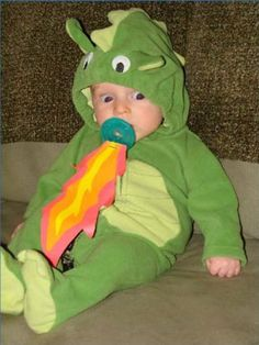 Baby dragon costume with flames on the pacifier.