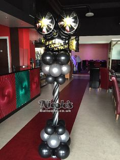 A Hollywood themed balloon column which was used for a birthday party Prom Balloons, Party Ballons, Balloons And More, Balloon Columns, Balloon Arch, Balloon Garland, Balloon Decorations, Movie Themes, Party Themes