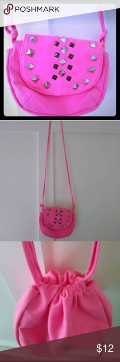 Victoria's secret pink purse A pink victoria's secret purse with a long strap and draw strap with silver studs /super cute Victoria's Secret Bags Crossbody Bags