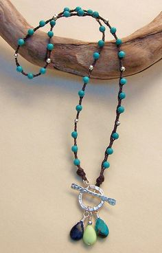 Another with the toggle in the front.  I like that idea .   Linen Necklace by Erin Siegel Jewelry, via Flickr
