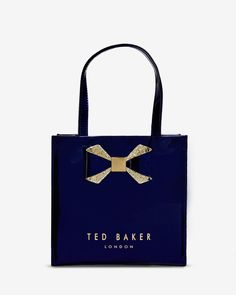 http://www.tedbaker.com/us/Womens/Accessories/Bags/SPARKON-Small-crystal-bow-trim-shopper-bag-Mid-Blue/p/122575-15-MID-BLUE