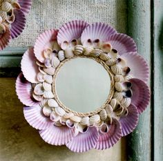 Scallop Shell Mirror. Attractively arranged natural sea shells catch the eye and reflective glass mirror catches the light, in our small decorative mirrors. Cluster the two sizes to create a wall of reflective art.