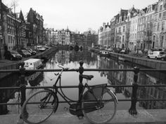 Black and White Imge of an Old Bicycle by the Singel Canal, Amsterdam, Netherlands, Europe Photographic Print by Amanda Hall at AllPosters.com