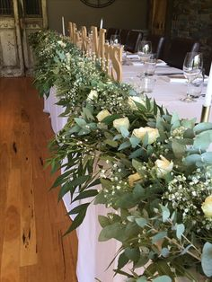 Floral garland - blue gum , babies breath and roses @weddingflowersetc