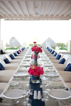 white table cloth, navy and pink accents
