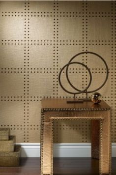 Studded wall - parchment or leather? wall covering?  It looks daunting but you could actually do this yourself, lay out the lines, apply nailheads.