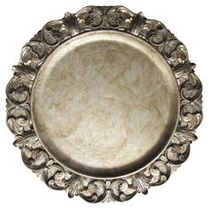 Bring timeless elegance to your tablescape with this eye-catching charger plate, showcasing a scrolling acanthus leaf border and a glamorous silver finish.
