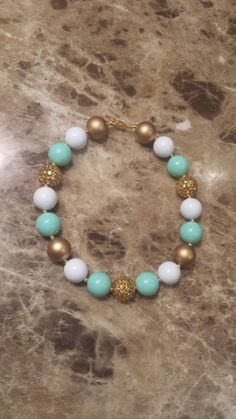 Check out this item in my Etsy shop https://www.etsy.com/listing/237499609/sale-ready-to-ship-mint-green-gold-white