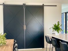 Custom built barn doors with a more traditional sleek finish than the usual chunky barn style match the modern sleek style of the home. Polished Concrete, Showcase Design, Concrete Floors, Hand Blown Glass, Glass Pendants, Barn Doors, Empire State, Luxury Homes, It Is Finished