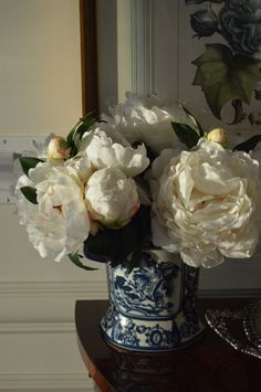 white flowers in a blue + white vase, dark antiques, botanical prints, painted woodwork
