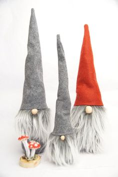 This adorable handmade felt gnome or tomte would make the perfect addition to your home or Christmas decor.  Hats are embroidered with a fun