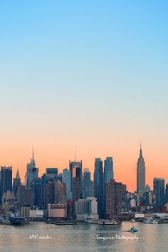 New York City sunset by Songquan Deng, via Flickr