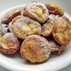 Aebleskiver - a Danish dessert, like doughnut holes, but sweeter and much better traditionally served with glogg during the Advent. Cooked in a cast iron pan that resembles an egg poacher. Serve hot with syrup, jam or powdered sugar.