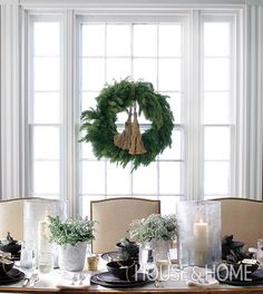 Tassels made from burlap lend this wreath a quiet sophistication in the formal dining room. | Photographer: Michael Graydon