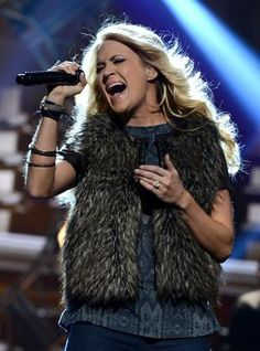Carrie Underwood performing at the American Music Awards. See More Great LIVE Country >> http://www.gactv.com/gac/ar_artists_a-z/article/0,3028,GAC_26071_6056807_63,00.html