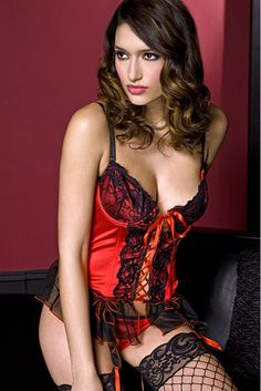 9586e79c50a Red satin, underwire bustier with a lace-up front, contrast lace trim  detail and attached garter clips. Thong and stockings not included.