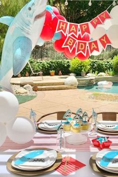 Don't miss this excellent shark-themed birthday party! The table settings are cool!  See more party ideas and share yours at CatchMyParty.com  #catchmyparty #partyideas #shark #sharkparty #boybirthdayparty #undertheseaparty