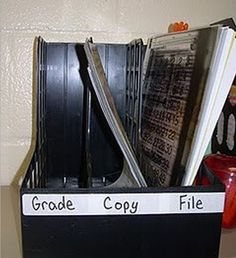 "Oh! Good idea. I was just going to have a ""to grade"" and ""graded""  bin behind my desk, but I like the idea of having a ""copy"" and ""file"" spot, too. :)"
