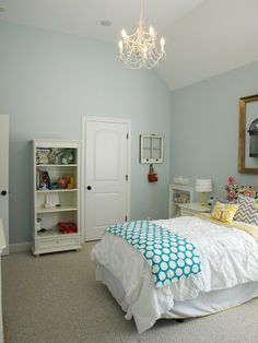 Wall paint color: Sherwin Williams tradewind at 75%. Bed was painted a pretty coral color,  Sherwin Williams Begonia.