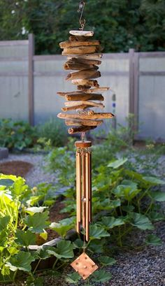 This natural Pacific driftwood wind chime is naturally beautiful.This wind chime measures about 53 inches long from the top of the copper hook to the bottom of the windsail. The driftwood section measures about 18 inches long and 9 inches wide.The driftwood is Pacific Coast rugged.The 5 handcrafted copper chimes have a