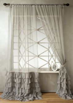 Not crazy about the ruffles but like the sheer with something more substantial-looking below the window sill