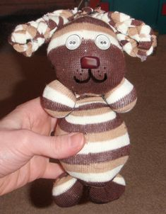 finished dogs step How to Make No Sew Stuffed Puppy Dog Animal Toy with Socks & Rubber Bands