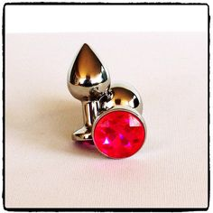 Lady Kink - Medium Stainless Steel Bullet Plug R This medium stainless steel plug makes anal play even more fun by adding a touch of glamour and bling with a glass jewel at the base. Silver Bullet, Fascinator, Plugs, Cufflinks, Bling, Glamour, Stainless Steel, Base, Jewels