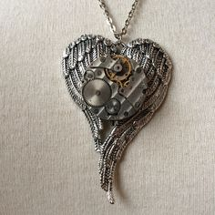 steampunk necklace http://steampunk-heaven.nl/product/steampunk-ketting-180-zilveren-vleugels-met-horloge-uurwerk/