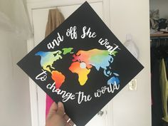 and off she went to change the world map painted graduation cap