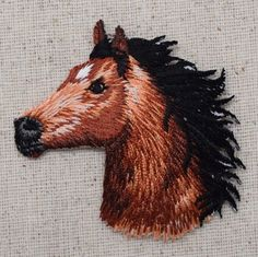 """Horse Head Facing Left Iron on Applique High quality, detailed embroidery applique. Can be sewn or ironed on. Great for hats, bags, clothing, and more! Size is approx. 2-1/4"""" or 5.7cm"""