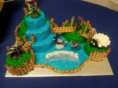 - Skylander cake (disclaimer...figures are the actual toys, except for the sheep). Buttercream, fondand logo, and cookies