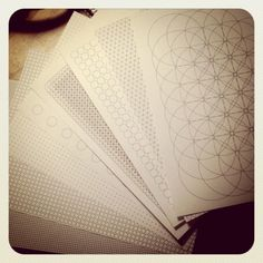 "Free downloadable ""graph paper coloring book"" / nine pages with grid or geometric patterns"